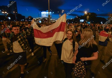 People attend a protest after polling stations closed in the presidential elections in Minsk, Belarus, 09 August 2020. Five candidates are contesting for the presidential seat, including Alexander Lukashenko, the incumbent President of Belarus.