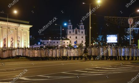 Police officers advance along a road during a protest after polling stations closed in the presidential elections in Minsk, Belarus, 09 August 2020. Five candidates are contesting for the presidential seat, including Alexander Lukashenko, the incumbent President of Belarus.