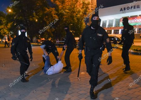 Police officers detain a demonstrator during a protest after polling stations closed in the presidential elections in Minsk, Belarus, 09 August 2020. Five candidates are contesting for the presidential seat, including Alexander Lukashenko, the incumbent President of Belarus.
