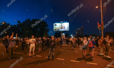 People react during a protest after polling stations closed in the presidential elections in Minsk, Belarus, 09 August 2020. Five candidates are contesting for the presidential seat, including Alexander Lukashenko, the incumbent President of Belarus.