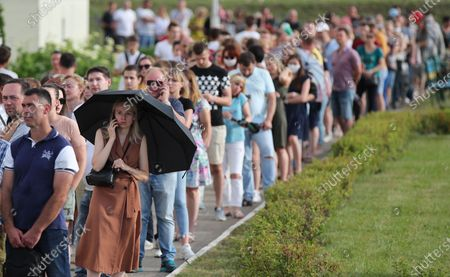 Belarusian people queue outside a polling station to cast their votes during the presidential elections at a polling station in Minsk, Belarus, 09 August 2020. Five candidates are contesting for the presidential seat, including the incumbent president Alexander Lukashenko.