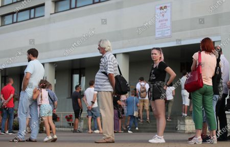 People wait in line outside a polling station to cast the vote during the presidential elections in Minsk, Belarus, 09 August 2020. Five candidates are contesting for the presidential seat, including the incumbent president Alexander Lukashenko.
