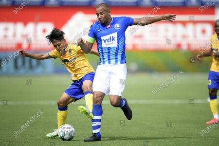 STVV's Lee Seung-woo and Gent's Vadis Odjidja-Ofoe fight for the ball during the Jupiler Pro League match between STVV and KAA Gent, in Sint-Truiden, Sunday 09 August 2020, on day 01 of the Belgian soccer championship.