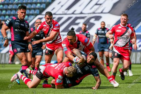 Stock Image of Hull FC's Albert Kelly is tackled by Salford's Joey Lussick and Pauli Pauli.