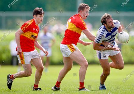 Stock Photo of Castlebar Mitchels vs Breaffy. Castlebar's Sean Conlon and Eoghan O'Reilly with Aidan O'Shea of of Breaffy