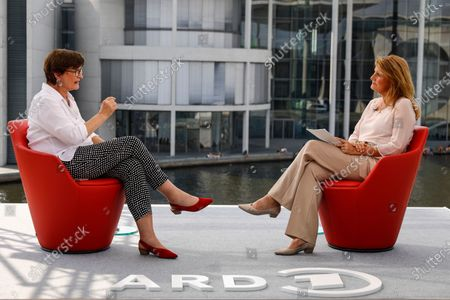 The co-chairwoman of the Social Democratic Party (SPD), Saskia Esken (L) speaks with German journalist Tina Hassel, during the traditional summer interview of the television show 'Report from Berlin' on German public broadcaster ARD, in Berlin, Germany, 09 August 2020