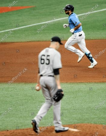 New York Yankees starter James Paxton (65) walks the mound after giving up a solo home run to Tampa Bay Rays' Brandon Loew, top, during the seventh inning of a baseball game, in St. Petersburg, Fla