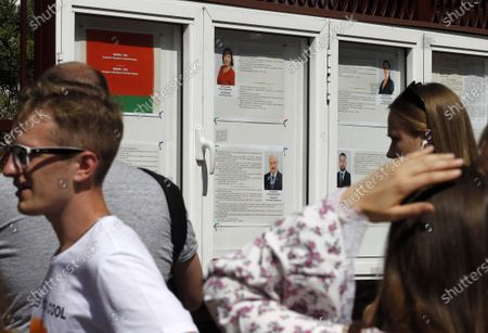 Presidential candidates information  seen on the board as Belarusian citizens wait for their turn to participate in the Belarusian Presidential election outside the Embassy of Belarus. Belarusian citizens who live in Ukraine come to participate in voting for the next Belarusian President at a polling station located at the Embassy of Belarus in Kiev. Presidential elections in Belarus are held on August 9, 2020