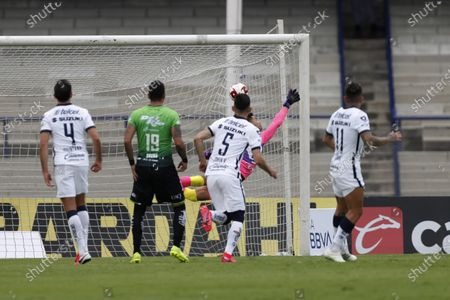 Stock Picture of Pumas' goalkeeper Alfredo Talavera, back, fails to stop a goal from Juarez's Maximiliano Olivera during a Mexican soccer league match at University Olympic Stadium in Mexico City, . The match was played without fans as a precaution against the coronavirus