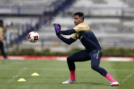 Stock Image of Pumas' goalkeeper Alfredo Talavera warms up prior to a Mexican soccer league match against Juarez at University Olympic Stadium in Mexico City