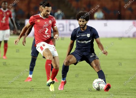 Al-Ahly player Ali Maaloul (L) in action against Enppi player Amr Nasser (R) during the Egyptian Premier League soccer match between Al-Ahly and Enppi, in Cairo, Egypt, 09 August 2020.