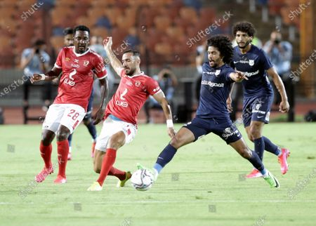 Al-Ahly player Ali Maaloul (C) in action against Enppi player Ahmed El Agouz (R) during the Egyptian Premier League soccer match between Al-Ahly and Enppi, in Cairo, Egypt, 09 August 2020.