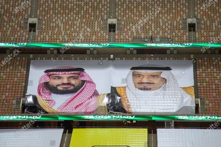Posters depicting Saudi Arabia's King Salman bin Abdulaziz Al Saud (R) and Crown Prince Mohammad Bin Salman Al Saud is displayed on empty seats of stadium before the Saudi Professional League soccer match between Al-Ittihad and Al-Ahli, Jeddah, Saudi Arabia, 09 August 2020.