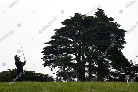 Mike Lorenzo-Vera, of France, watches his tee shot on the third hole during the final round of the PGA Championship golf tournament at TPC Harding Park, in San Francisco