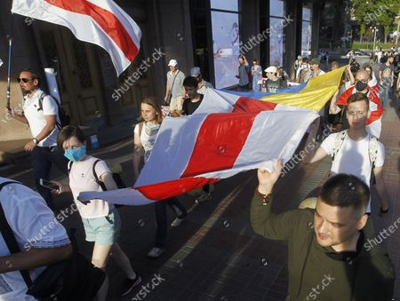 Belarusian citizens in Ukraine hold Belarusian flags during a rally in solidarity with Belarus opposition outside the Embassy of Belarus. The presidential elections in Belarus will take place on August 9, 2020.