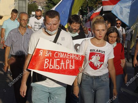 An activist carries a placard saying I am for fair elections during a rally in solidarity with Belarus opposition outside the Embassy of Belarus. The presidential elections in Belarus will take place on August 9, 2020.