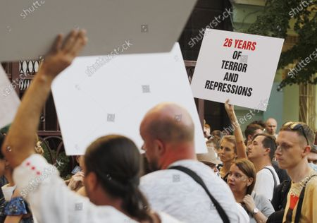 A Belarusian citizen in Ukraine holds a placard during a rally in solidarity with Belarus opposition outside the Embassy of Belarus. The presidential elections in Belarus will take place on August 9, 2020.
