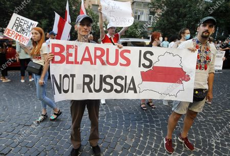 Belarusian citizens in Ukraine hold a banner, placards and Belarusian flags during a rally in solidarity with Belarus opposition outside the Embassy of Belarus. The presidential elections in Belarus will take place on August 9, 2020.