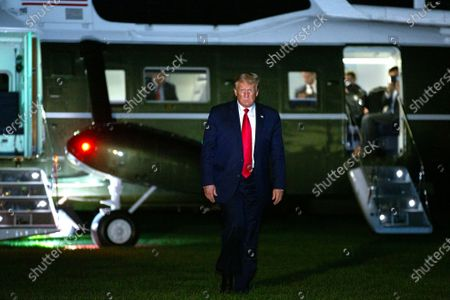 Stock Image of United States President Donald Trump walks on the South Lawn after arriving at the White House in Washington, DC, USA, 09 August 2020. Trump announced four executive actions on 08 August, including a temporary payroll tax deferral for some workers and continued expanded unemployment benefits, as the coronavirus pandemic continues to hobble the US economy. Trump was returning from Bedminster.