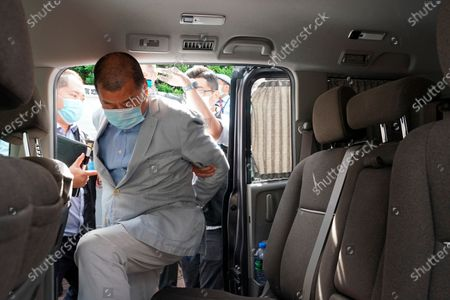 Hong Kong media tycoon Jimmy Lai, who founded local newspaper Apple Daily, gets into a car after being arrested by police officers at his home in Hong Kong, . Lai was arrested Monday on suspicion of collusion with foreign powers, his aide said, in the highest-profile use yet of the new national security law Beijing imposed on the city after protests last year