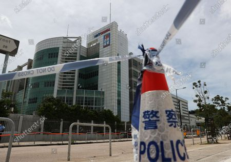 Police cordons are set up outside the Apple Daily headquarters after media tycoon and founder of Apple Daily Jimmy Lai was arrested at his home in Hong Kong, China, 10 August 2020. On 10 August, under the new and controversial national security law, Hong Kong police arrested Jimmy Lai and raided the Apple Daily headquarters. According to media reports six others have also been arrested.