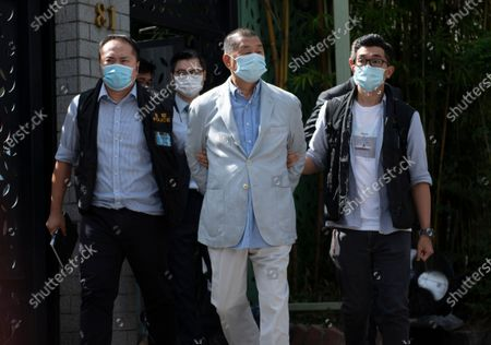 Jimmy Lai (C), media tycoon and founder of Apple Daily, is escorted by police after he was arrested at his home in Hong Kong, China, 10 August 2020. On 10 August, under the new and controversial national security law, Hong Kong police arrested Jimmy Lai and raided the Apple's Daily headquarter. According to media reports six others have also been arrested.