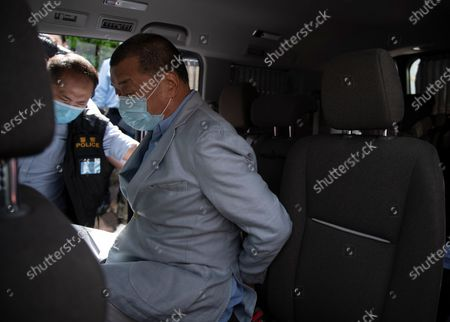 Stock Picture of Jimmy Lai (R), media tycoon and founder of Apple Daily, placed in a vehicle by police after he was arrested at his home in Hong Kong, China, 10 August 2020. On 10 August, under the new and controversial national security law, Hong Kong police arrested Jimmy Lai and raided the Apple's Daily headquarter. According to media reports six others have also been arrested.