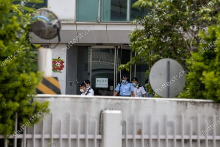 Police officers walk out of the Apple Daily headquarters after media tycoon and founder of Apple Daily Jimmy Lai was arrested at his home in Hong Kong, China, 10 August 2020. On 10 August, under the new and controversial national security law, Hong Kong police arrested Jimmy Lai and raided the Apple Daily headquarters. According to media reports six others have also been arrested.