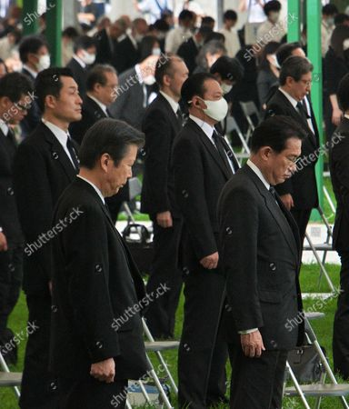 Chairman of Policy Research Council of Liberal Democratic Party, Fumio Kishida and Chief Representative of New Komeito, Natsuo Yamaguchi offer a silent prayer during the ceremony of the 75th anniversary memorial service for atomic bomb victims at Hiroshima Peace Memorial Park in Hiroshima, Japan.