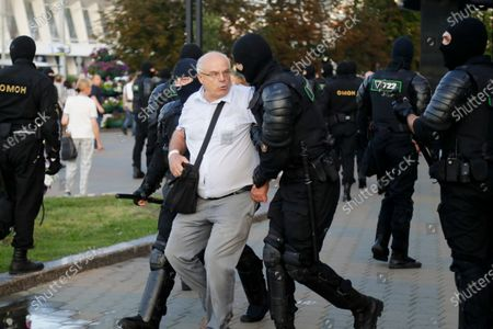 Police detain a man during a protest following presidential elections in Minsk, Belarus, . Thousands of people have protested in Belarus for a second straight night after official results from weekend elections gave an overwhelming victory to authoritarian President Alexander Lukashenko, extending his 26-year rule. A heavy police contingent blocked central squares and avenues, moving quickly to disperse protesters and detained dozens