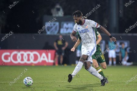 Cincinnati defender Kendall Waston (2) passes a ball in front of Portland Timbers forward Jaroslaw Niezgoda (11) during the second half of an MLS soccer match, in Kissimmee, Fla