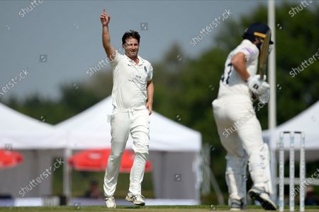 Stock Photo of Tim Murtagh of Middlesex celebrates the wicket of Ryan Stevenson during the Bob Willis Trophy match between Middlesex County Cricket Club and Hampshire County Cricket Club at Radlett, Radlett