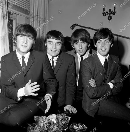 (L-R) English singer, songwriter and guitarist John Lennon, English musician, singer-songwriter and guitarist George Harrison and English singer-songwriter and multi-instrumentalist Sir Paul McCartney of the Beatles pose for a portrait with British drummer Jimmie Nicol, who was replacing Ringo Starr for two weeks while Ringo had tonsillitis during their world tour on June 12, 1964 at the Centennial Hall in Adelaide, Australia
