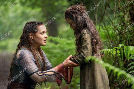 Katherine Langford as Nimue and Eiry Shi as Snake Girl