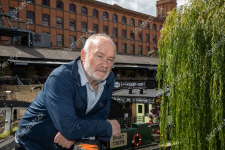 Vince Power, Irish music venue and festival owner and founder of Mean Fiddler who lives and operates in London. He is photographed at Camden Lock, near to Dingwalls which he purchased in June 2020.