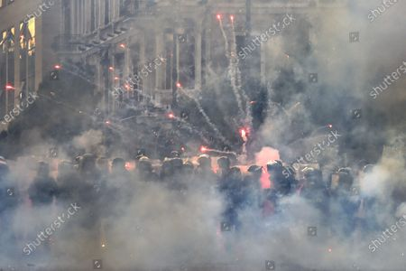 Anti-government protesters use fireworks against Lebanese riot police during a protest at one of the roads leading to the parliament in downtown Beirut, Lebanon, 10 August 2020. Lebanese government resigned amid continuing protests over the Beirut port explosion. Beirut governor said at least 200 people were killed in the explosion on 04 August and dozens are still missing.