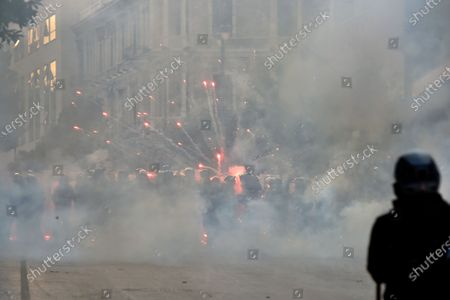 Anti-government protesters use fireworks against Lebanese riot police during a protest at one of the roads leading to the parliament in Beirut, Lebanon, 10 August 2020. Lebanese government resigned amid continuing protests over the Beirut port explosion. Beirut governor said at least 200 people were killed in the explosion on 04 August and dozens are still missing.