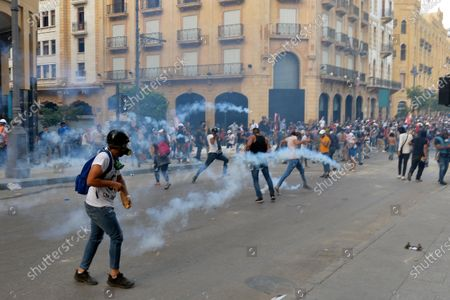 Riot police fire tear gas against anti-government protesters during a protest at one of the roads leading to the parliament in downtown Beirut, Lebanon, 10 August 2020.  Lebanese government resigned amid continuing protests over the Beirut port explosion. Beirut governor said at least 200 people were killed in the explosion on 04 August and dozens are still missing.