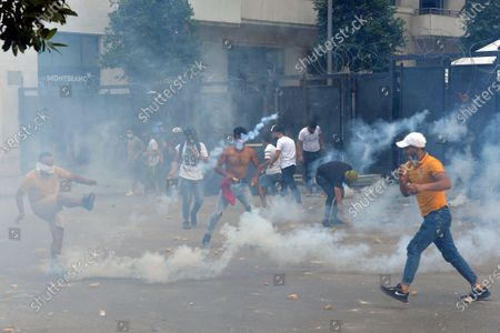 Riot police fire tear gas against anti-government protesters during a clash at one of the roads leading to the parliament in Beirut, Lebanon, 10 August 2020. Lebanese government resigned amid continuing protests over the Beirut port explosion. Beirut governor said at least 200 people were killed in the explosion on 04 August and dozens are still missing.
