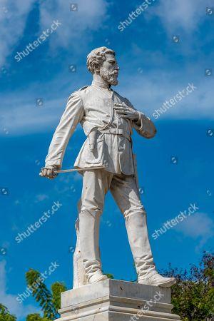 Julio Grave de Peralta Zayas-Bazan white marble statue in the city center which is a tourist attraction.