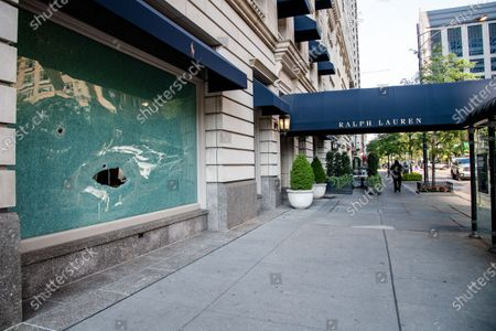 Broken windows are seen at a Ralph Lauren following a night of civil unrest & looting in downtown Chicago following the shooting of an Englewood man on August 10, 2020 in Chicago, Illinois.