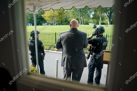 Secret Service Police stand outside the James Brady Press Briefing Room at the White House, in Washington, as a news conference by President Donald Trump was paused