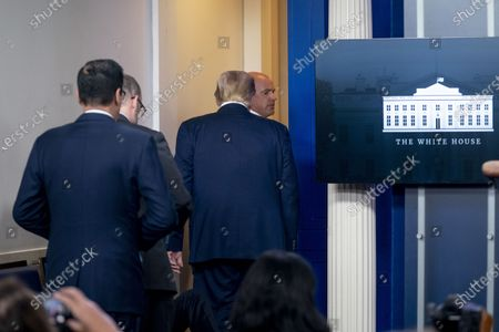 President Donald Trump is asked to leave the James Brady Press Briefing Room by a member of the U.S. Secret Service during a news conference at the White House