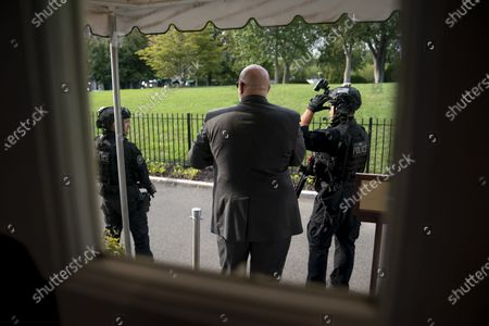Member of the U.S. Secret Service stand outside the James Brady Press Briefing Room at the White House, in Washington, as a news conference by President Donald Trump was paused by a security incident outside the fence of the White House