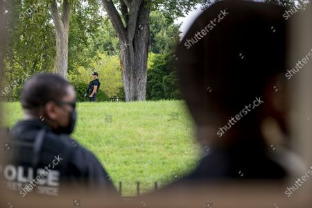 Members of the U.S. Secret Service stand guard outside the James Brady Press Briefing Room as President Donald Trump holds a news conference at the White House, in Washington. Trump briefly left because of a security incident outside the fence of the White House