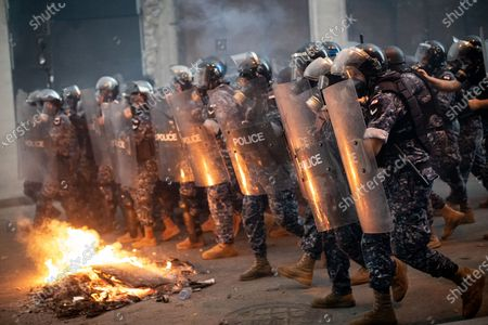 Police and army clash with demonstrators as they protest against the government following a huge explosion in Beirut port on 4 August.
