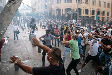 Demonstrators pull down a concrete defence wall during clashes with the police and army as they protest against the government following a huge explosion in Beirut port on 4 August.