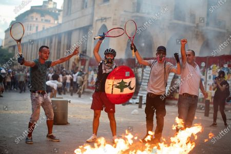 Demonstrators clash with the police and army as they protest against the government following a huge explosion in Beirut port on 4 August.