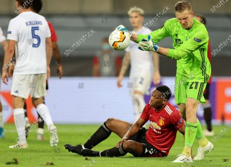Stock Photo of Copenhagen's goalkeeper Karl-Johan Johnsson, right, reacts after Manchester United's Anthony Martial, down, was fouled in the penalty box during the UEFA Europa League quarterfinal soccer match between Manchester United and FC Copenhagen in Cologne, Germany