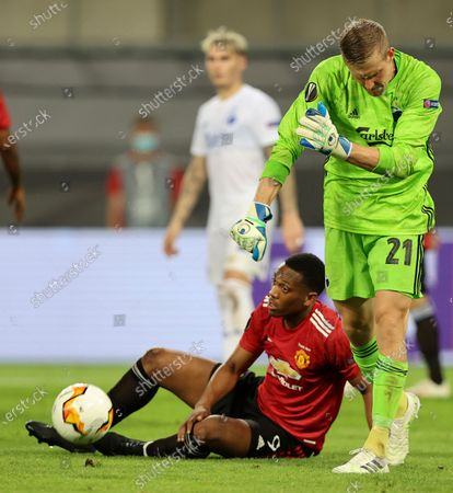 Stock Picture of Copenhagen's goalkeeper Karl-Johan Johnsson, right, reacts after Manchester United's Anthony Martial, down, was fouled in the penalty box during the UEFA Europa League quarterfinal soccer match between Manchester United and FC Copenhagen in Cologne, Germany
